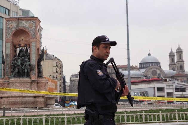 ISTANBUL, TURKEY - MARCH 19: A Turkish police stands guard in central Taksim square following a suicide bombing in a major shopping and tourist district in the central part of the city on March 19, 2016 in Istanbul, Turkey. The explosion on Istanbul's main pedestrian shopping Istiklal street today killed at least four people and left many injured. (Photo by Burak Kara/Getty Images)