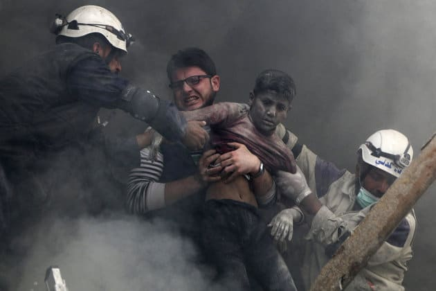 ATTENTION EDITORS - VISUAL COVERAGE OF SCENES OF INJURY OR DEATH Men rescue a boy from under the rubble after what activists said was explosive barrels dropped by forces loyal to Syria's President Bashar Al-Assad in Al-Shaar neighbourhood of Aleppo April 6, 2014. REUTERS/Hosam Katan (SYRIA - Tags: POLITICS CIVIL UNREST CONFLICT TPX IMAGES OF THE DAY)